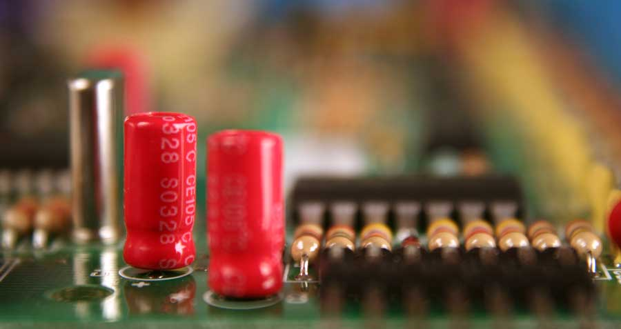 Masking a circuit board before coating