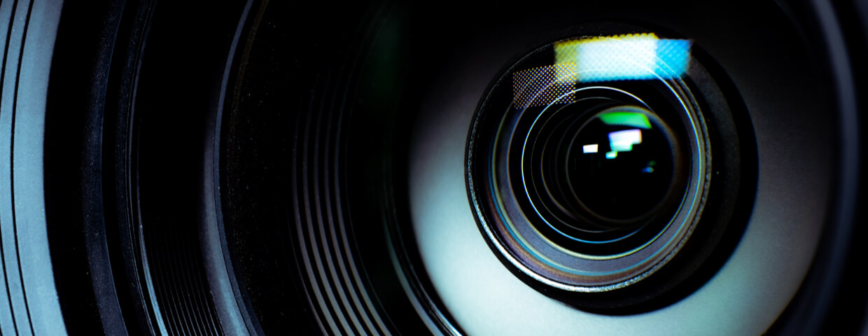 close up of a camera lens showing reflection and protective coating